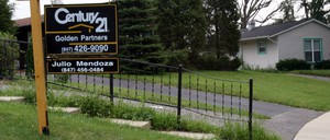 A for sale sign in Carpentersville, Ill., a town with a population that is approximately 50 percent Hispanic.
