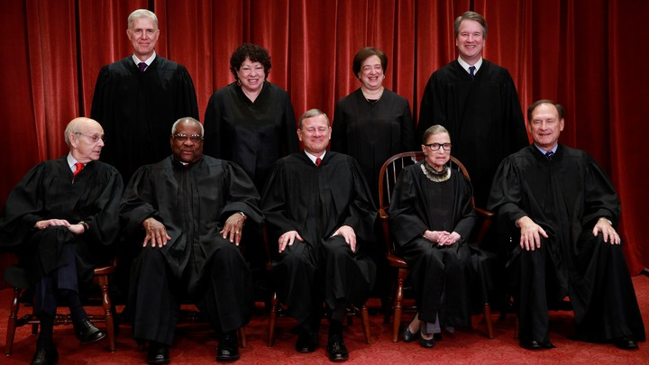 The U.S. Supreme Court justices pose for their group portrait on November 30, 2018.