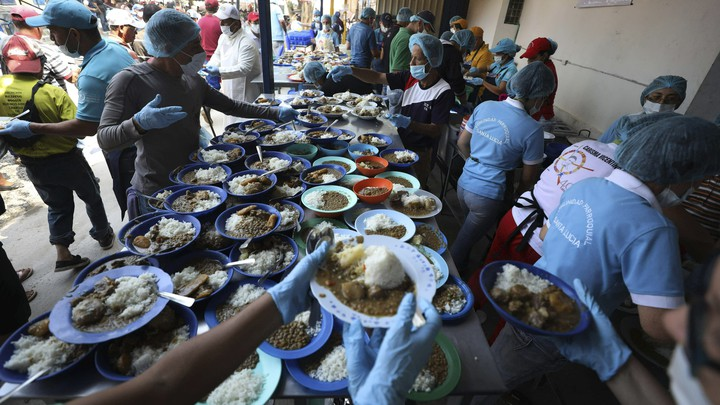 Volunteers prepare free lunches at a shelter near Cúcuta, Colombia.