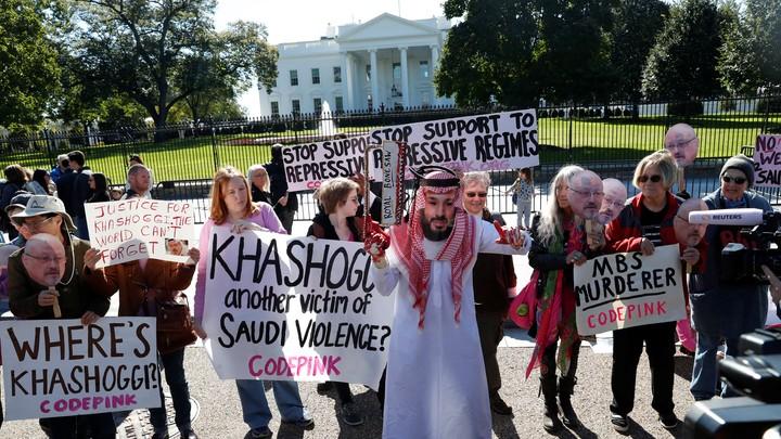Demonstrators call for sanctions against Saudi Arabia outside the White House on October 19, 2018.