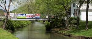 State and local campaign signs hang along a bridge outside of Charleston, West Virginia, 2018.