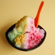 A small bowl of colorful shaved ice