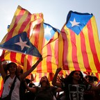 Protesters display Catalonian separatist flags in Barcelona on Tuesday.
