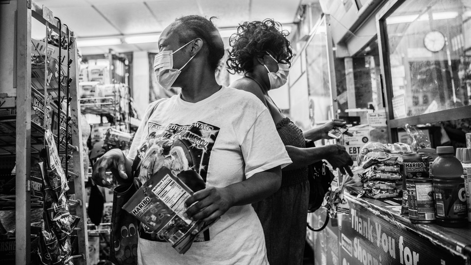People in New Orleans do last-minute shopping ahead of Hurricane Ida.