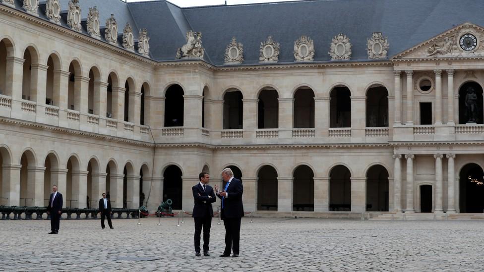 U.S. President Donald Trump talks to President Emanuel Macron of France in Paris in July.