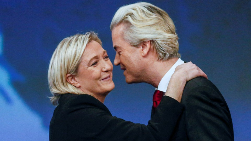 Marine Le Pen, head of France's National Front, greets Geert Wilders, president of the Netherlands's Party for Freedomin Lyon, France, on November 29, 2014.