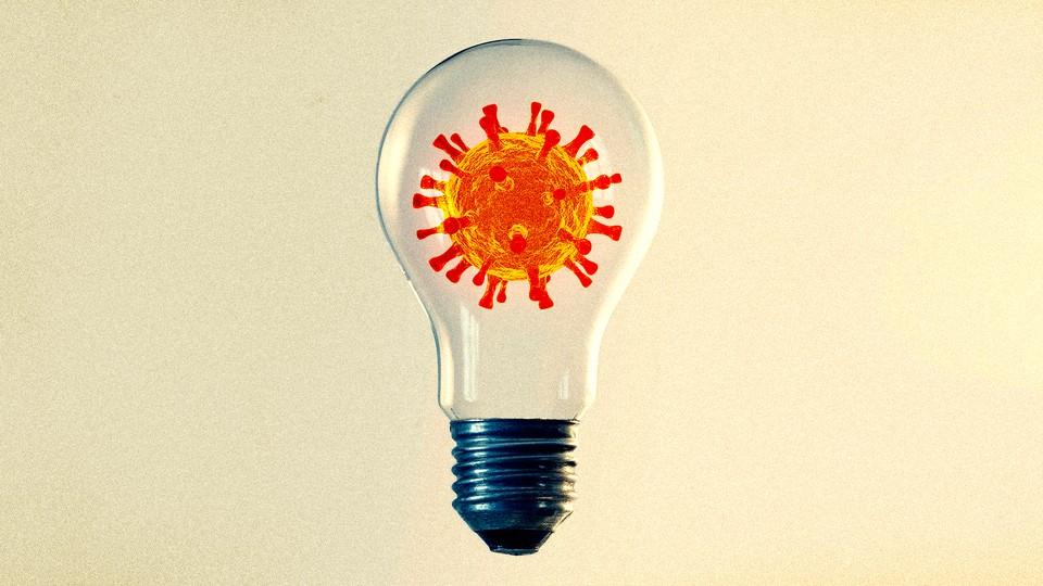 Illustration of a light bulb with the coronavirus inside it