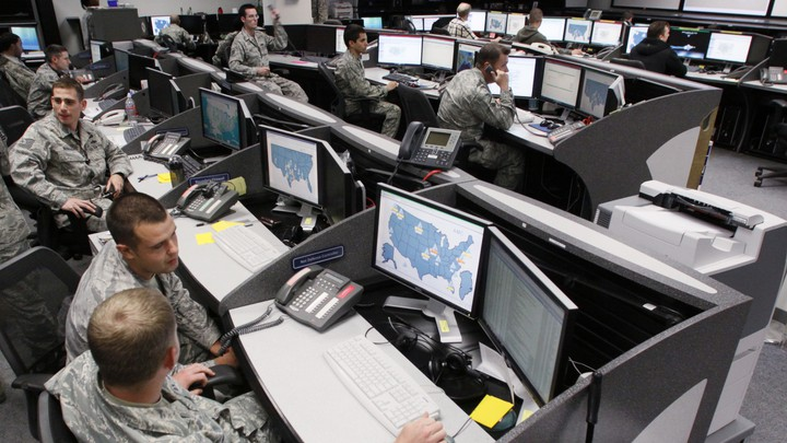 Personnel work at the Air Force Space Command Network Operations and Security Center at Peterson Air Force Base in Colorado.