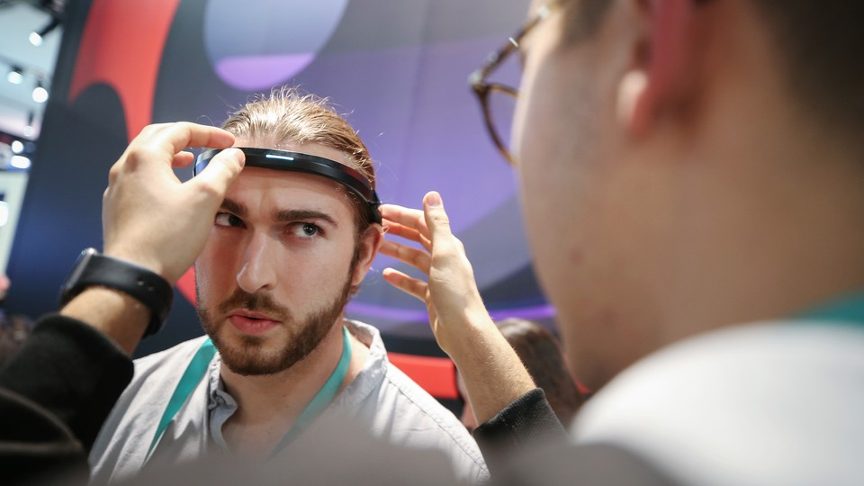 A person is outfitted with a headband for detecting brain activity at the Consumer Electronics Show 2020.