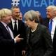 Boris Johnson greets Donald Trump; Theresa May faces away.