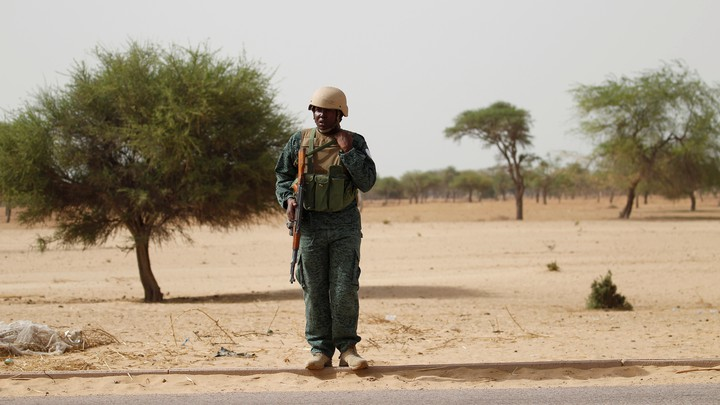 A Nigerian soldier stands guard following attacks by Boko Haram in June 2016.