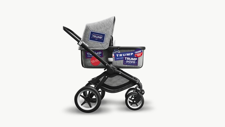 A baby stroller with Trump bumper stickers on it