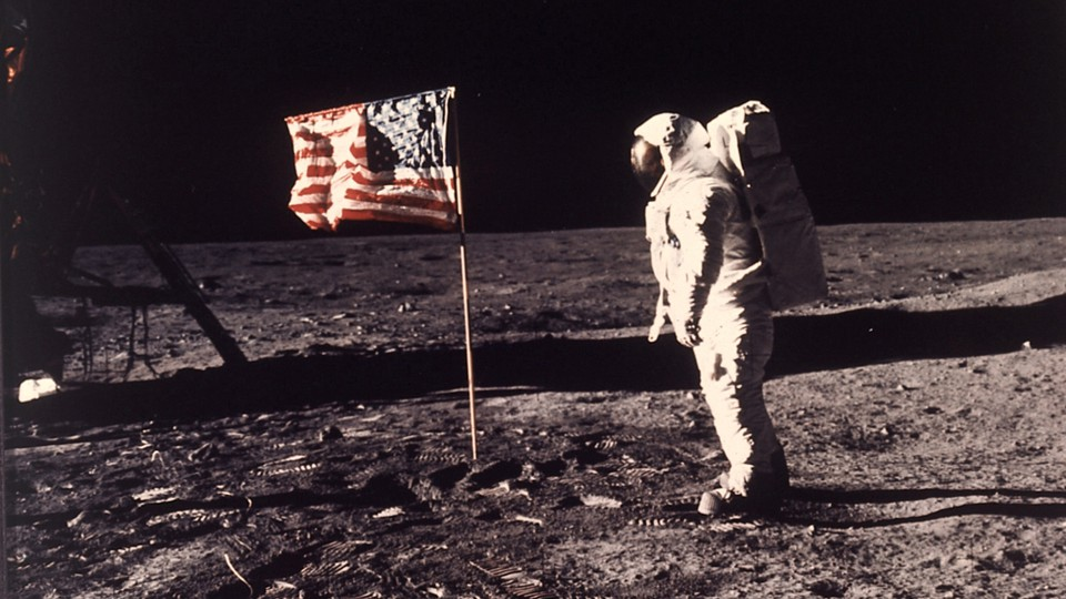 In a photo from 1969, Buzz Aldrin stands next to an American flag on the moon.