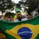 A protester holding a Brazilian flag