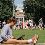 A woman on a laptop outdoors at University of North Carolina at Chapel Hill
