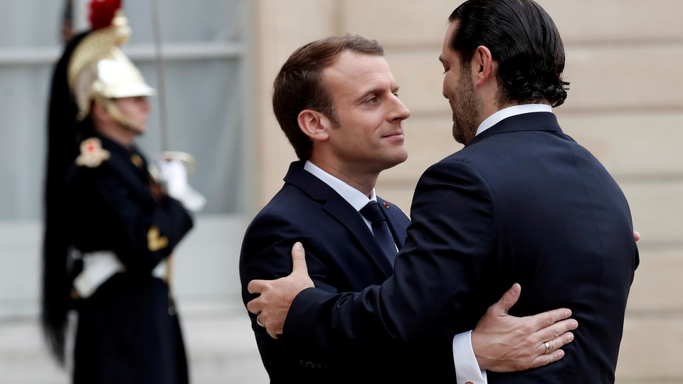 Emmanuel Macron and Saad al-Hariri embrace.