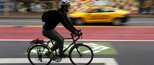 A cyclist rides on the bike lane in the Mid Market neighborhood during Bike to Work Day in San Francisco,