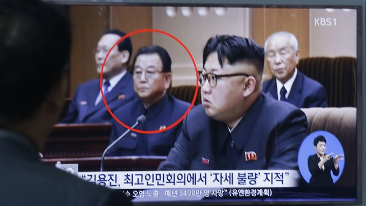 Kim Yong-jin, the vice premier on education affairs, and North Korean leader Kim Jong-un