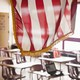 An American flag hangs above a classroom