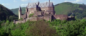 A photo of the Vianden castle rising above the tree-covered Ardennes hills in northern Luxembourg
