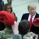 Donald Trump holds a cap while visiting U.S. troops at Ramstein Air Base in Germany on December 27, 2018.