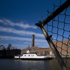 A ferry docked next to a warehouse in Long Island City, Queens