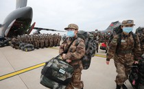 Medical personnel are transported by People's Liberation Army aircraft.
