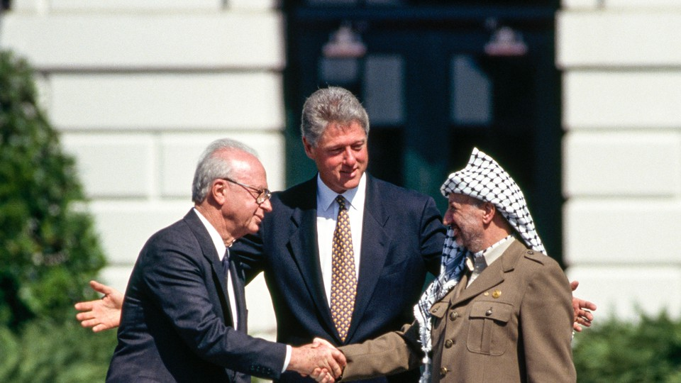 Bill Clinton with Yitzhak Rabin and Yasser Arafat at the White House in 1993.