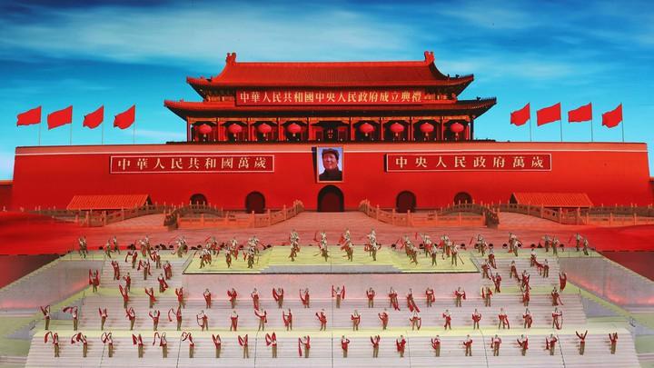 Actors practice commemoration ceremonies in front of Beijing's Forbidden City.