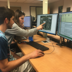 University of Maryland students Kurt Willson and Shannon Corrigan work to map a bus route in Loudon County, Virginia.