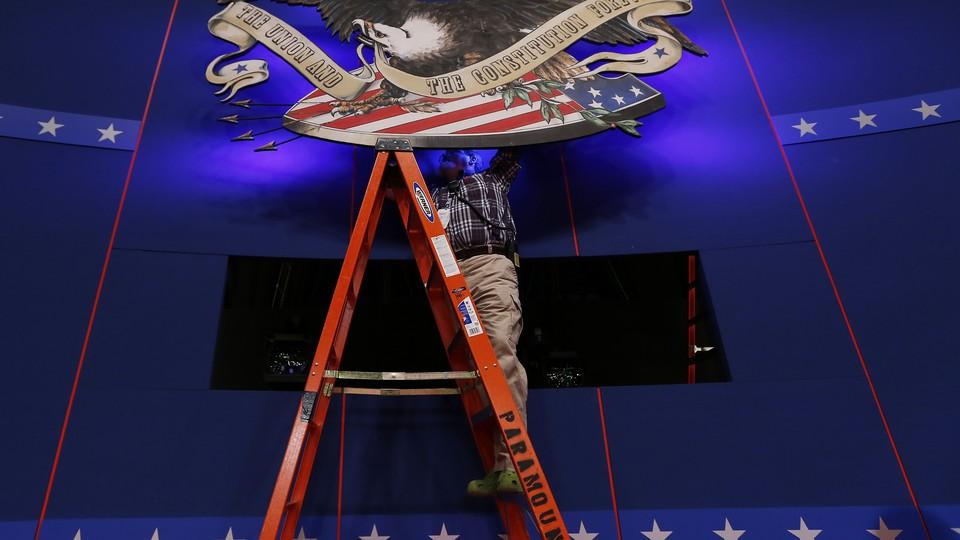 A technician prepares a presidential debate stage in 2012.