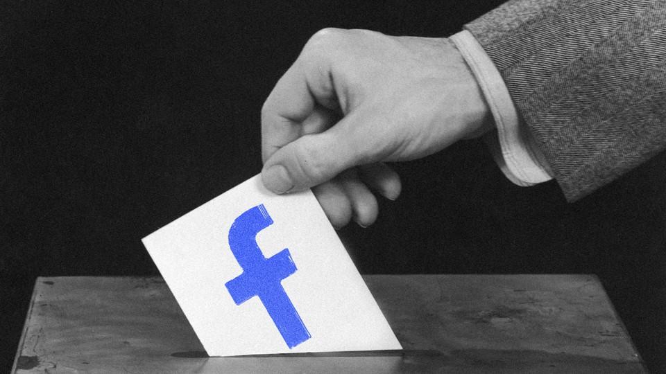 A hand puts a ballot into a ballot box. The ballot has the Facebook logo illustrated on it.