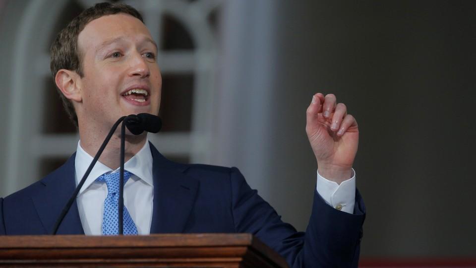 Mark Zuckerberg stands at a podium.