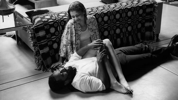 Zendaya and John David Washington lying on the ground in 'Malcolm & Marie'