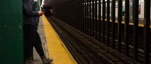 photo: A passenger in Brooklyn waits for a subway train.