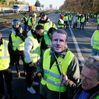 "A man wears a mask with the likeness of French president Emmanuel Macron as people take part in the nationwide ""Yellow Vest"" demonstrations, a symbol of a French drivers' protest against higher fuel prices, in Haulchin, France."
