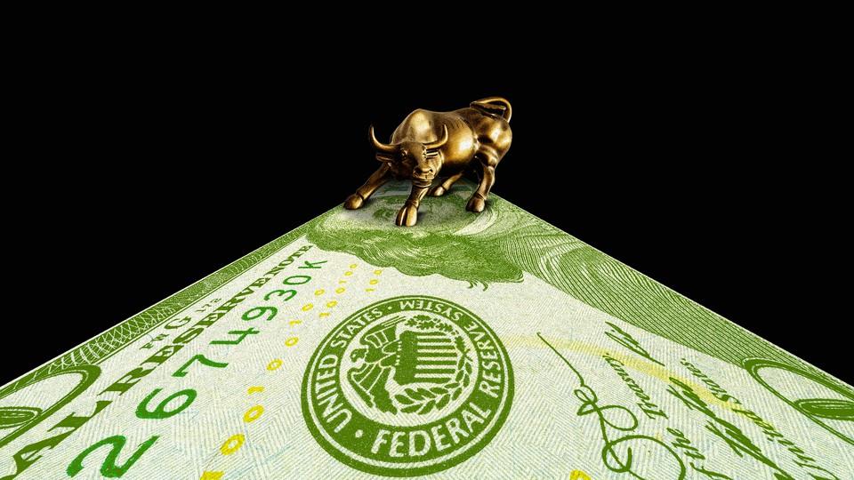 A golden bull on a U.S. dollar