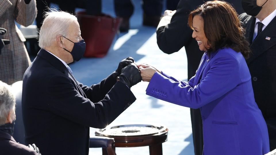 President-elect Joe Biden and Vice President Kamala Harris bump fists during their inauguration ceremony.