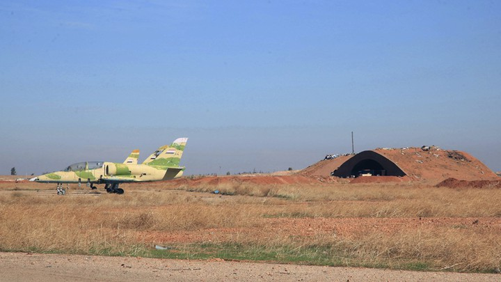 Warplanes inside the Kweiras air base, east of Aleppo, Syria.