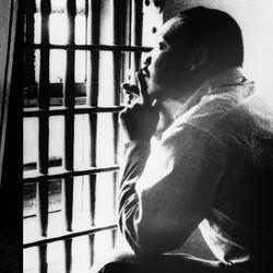 2 photos: King mug shot, 1956; King in jail, 1967