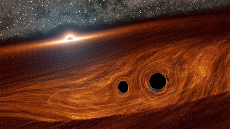 Artist's concept of a supermassive black hole and its surrounding disk of gas, with two smaller black holes embedded within
