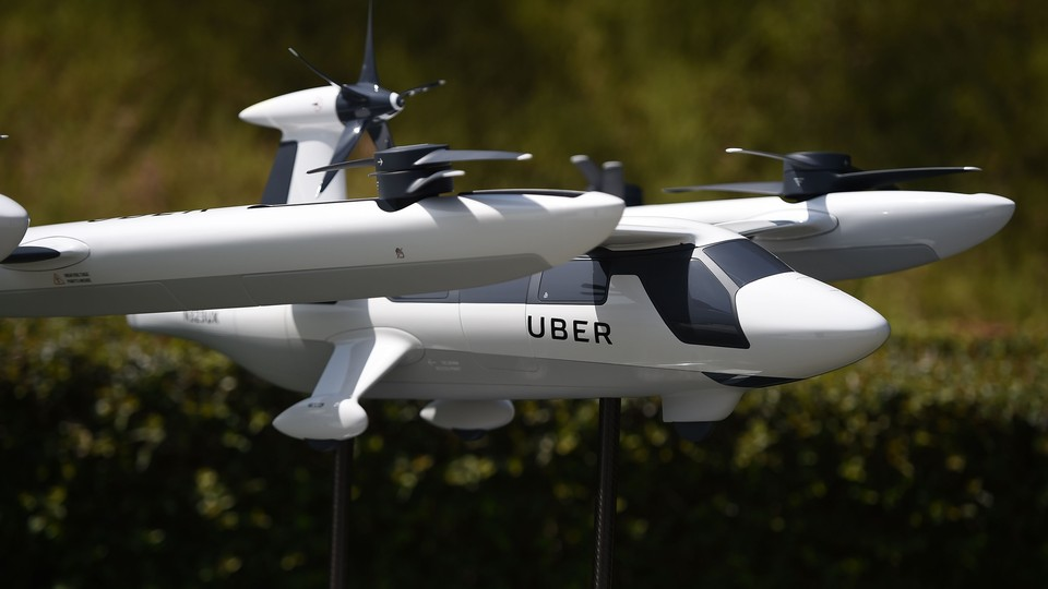 A model of Uber's flying taxi is displayed at the Uber Elevate Summit on May 8, 2018.