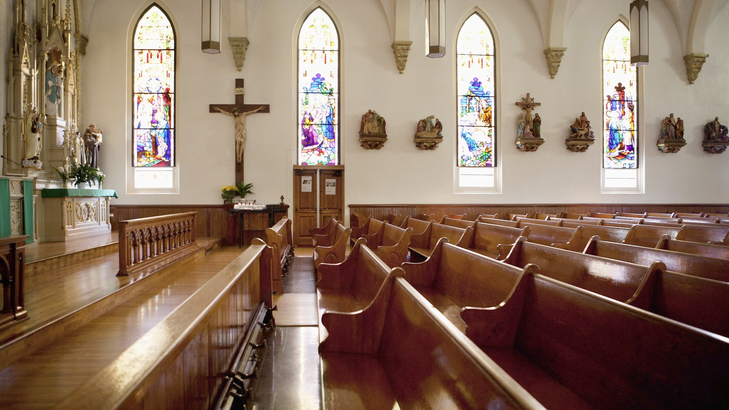 Pews and stained glass windows in church.
