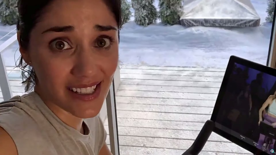 A woman in a Peloton commercial looks very scared.