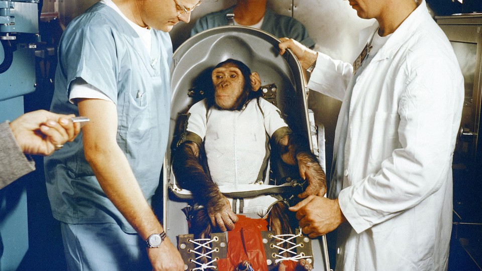 Ham the chimpanzee, with veterinarian Bill Britz in the white coat, in 1961