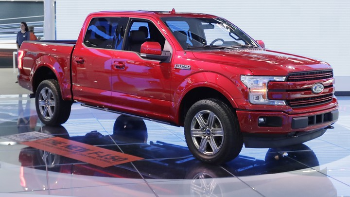A red Ford four-door pickup truck