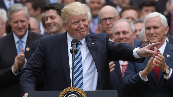 President Trump celebrates the House's passage of Obamacare repeal in May 2017.