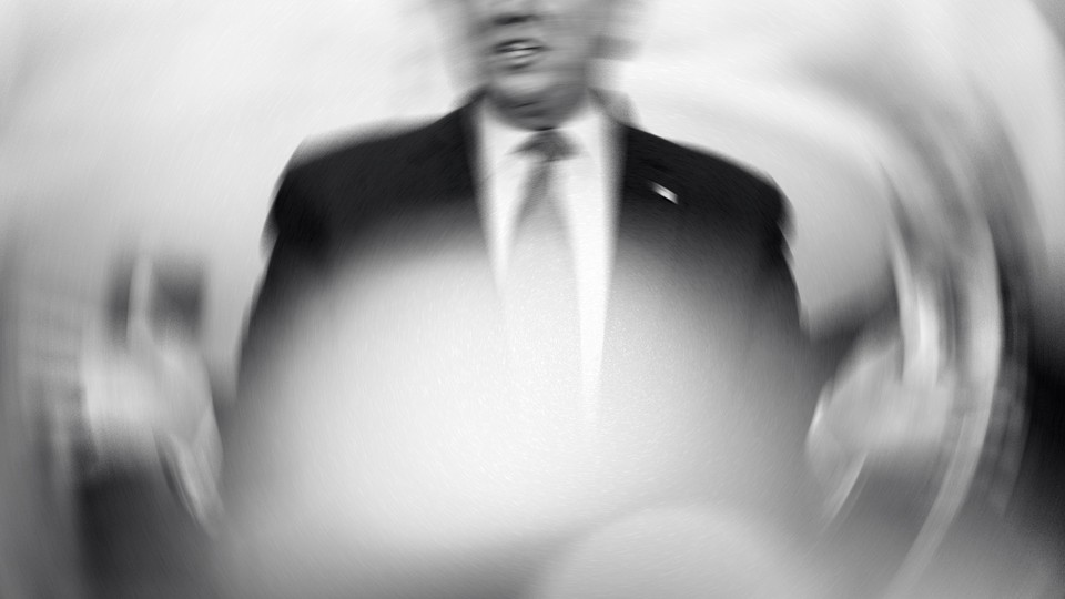 A shaken, overexposed black-and-white photo of Donald Trump speaking