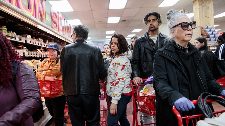 Grocery shoppers in a Trader Joe's