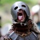 """Participants dressed as dwarves, goblins, orcs, and other characters re-enact a battle from """"The Hobbit,"""" in a forest in the Czech Republic in 2016."""